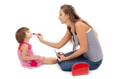 Young Mother Paints Little Girl Cosmetics Royalty Free Stock Photos