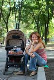 Young mother with perambulator Royalty Free Stock Photo