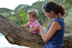 Young mother play outdoor with her baby Stock Photos