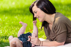 Young mother playing with baby Stock Images