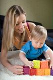 Young mother playing with baby boy. ( 1 year old ) at home Royalty Free Stock Image