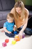 Young mother playing with baby boy Stock Image