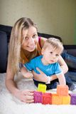 Young mother playing with baby boy Stock Photography