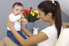 Young mother playing with baby boy Stock Photo