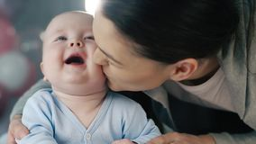 Cheerful baby with his mother stock footage