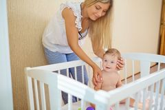 Young mother playing with baby. stock images