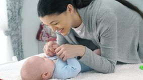 Mother Talking with a Baby. Young mother playing with baby stock footage