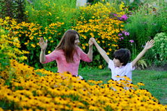 Young mother playing with children in park Stock Image
