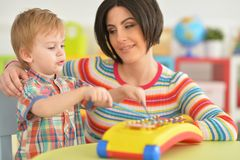 Young mother playing with son Stock Image