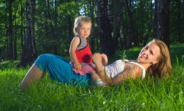Young mother playing with daughter royalty free stock image