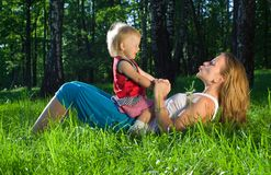 Young mother playing with  daughter Stock Image