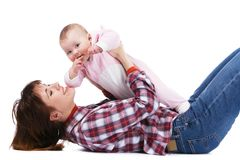 Young mother playing with her baby Royalty Free Stock Photography