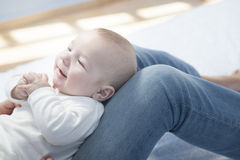 Young mother playing with her baby after feeding breast Stock Photography