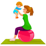 Mother and baby. Young mother playing with her baby on a gymnastic ball Royalty Free Stock Image