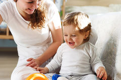 Young mother playing with her baby son Stock Images