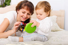 Young mother playing with her baby son Stock Photos