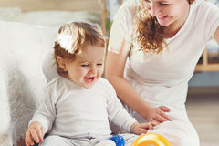 Young mother playing with her baby son Royalty Free Stock Photo