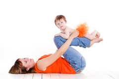 Young mother playing with her little daughter. Royalty Free Stock Image
