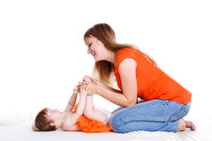 Young mother playing with her little daughter. Stock Images