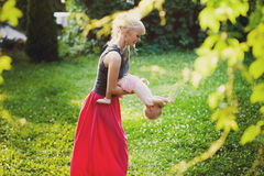Young mother playing with her little daughter on the nature Stock Images