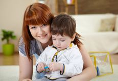 Young mother playing with her little son Stock Photography