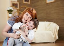Young mother playing with her little son Stock Images
