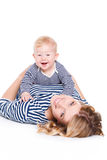 Young mother playing with her little son. Stock Image