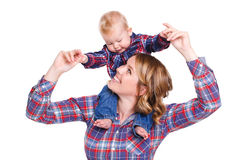 Young mother playing with her little son. Stock Photo
