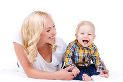 Young mother playing with her little son. Royalty Free Stock Photo