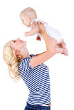 Young mother playing with her little son. Royalty Free Stock Image