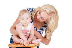 Young mother playing with her little son. Stock Photos