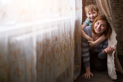 Young mother playing with her little son in the room. Love. Stock Image