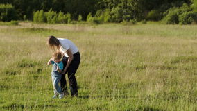 Young mother playing with her son outdoor stock footage