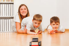 Young mother is playing with her two sons Royalty Free Stock Images
