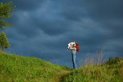 Young mother playing with little daughter in summer field. royalty free stock photography
