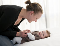 Young mother playing with sweet baby girl Royalty Free Stock Photos