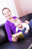 Young mother, plays the gay son. Royalty Free Stock Images