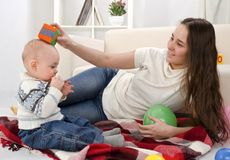 Young mother plays with her baby Royalty Free Stock Image
