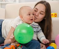 Young mother plays with the small son Stock Images