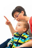 Young mother point finger to the up corner Stock Image