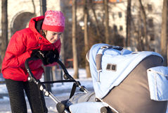 Young mother with a pram Royalty Free Stock Image