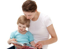 Young mother reading a book for little daughter Stock Image