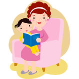 Young mother reading book to her daughter Royalty Free Stock Photo