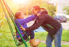 Young Mother Riding Little Daughter on Seesaw in Spring Park. Young Mother Little Daughter on Seesaw in Spring Park Sprtive Casual Clothing Woman and Little Stock Images