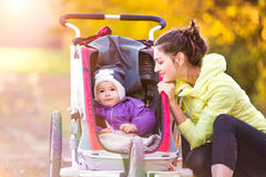 Young mother running Stock Photography