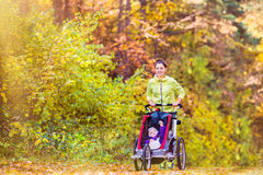 Young mother running Royalty Free Stock Photography