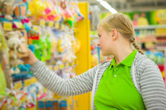 Young mother select kids toys in supermarket Royalty Free Stock Photos