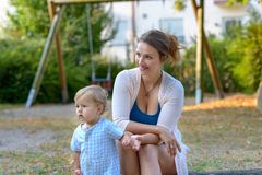 Free Young Mother Sitting In A Playground With Her Baby Stock Photography - 123502522