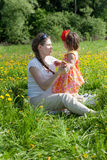 Young mother with the small daughter Stock Images