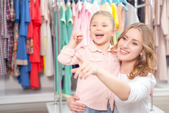 Young mother with small daughter in a fashion Stock Photos